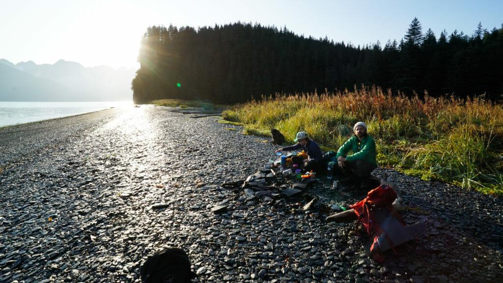 Hikers enjoy sunrise on Resurrection Bay, Alaska.