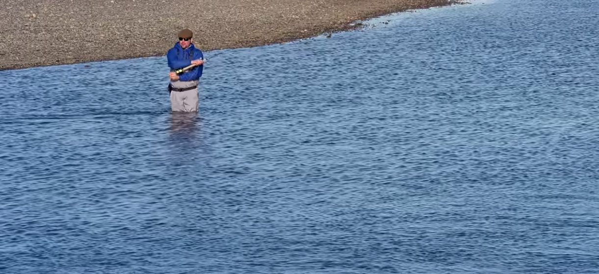 An angler fishes for sea-run brown trout on Tierra del Fuego's Rio Grande River.