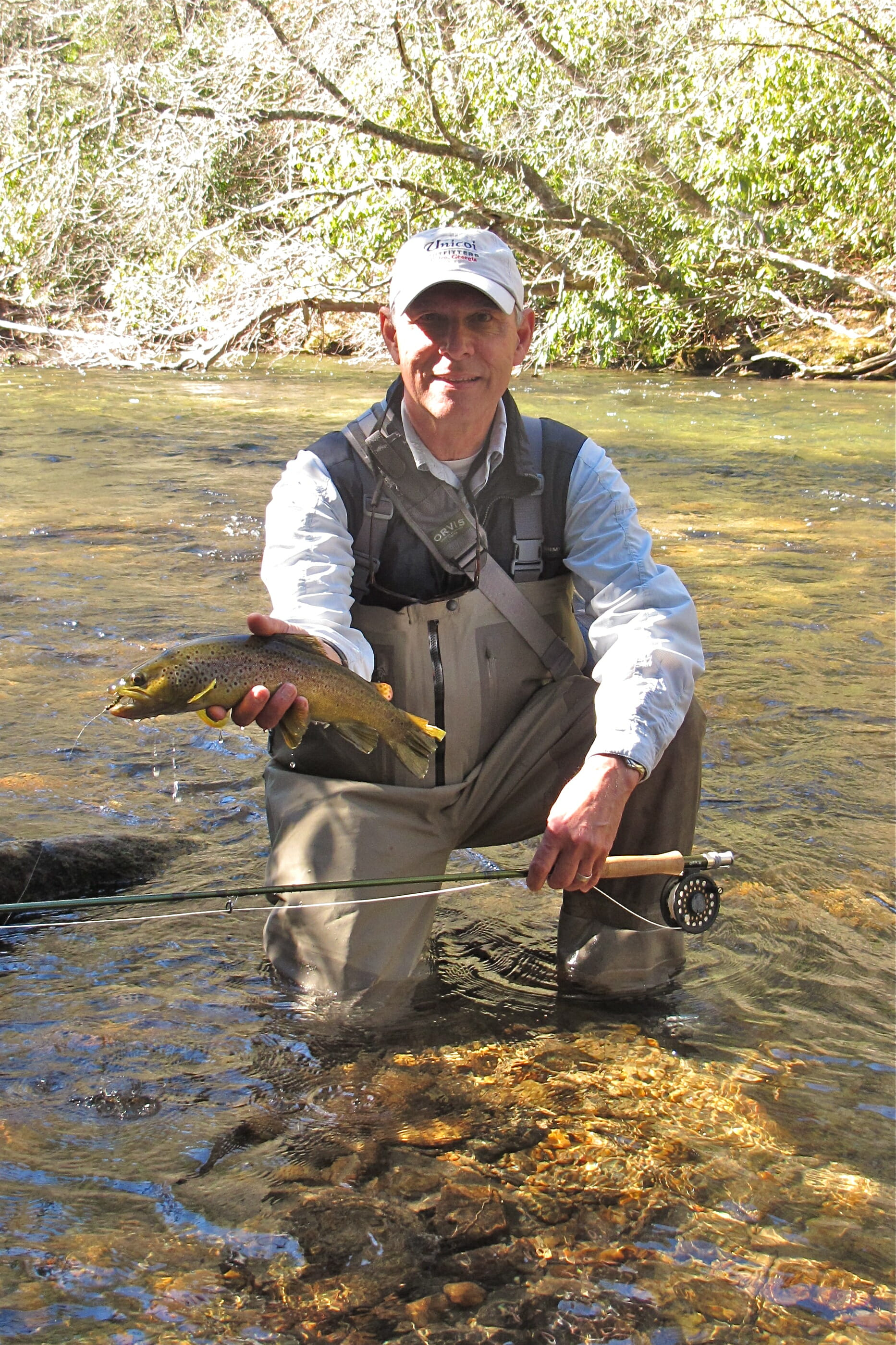 Outfitter Jimmy Harris poses with a nice trout.