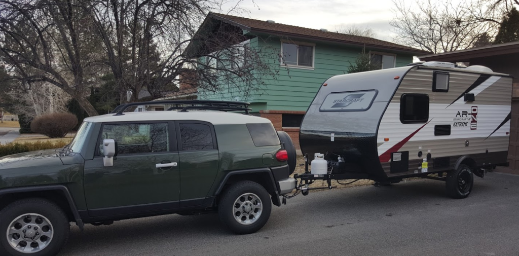 A Toyota FJ Cruiser hooked up to a Starcraft AR One Extreme camper, 2016.
