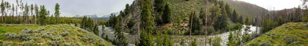 The Salmon River flows beneath the Sawtooth Mountains of central Idaho.