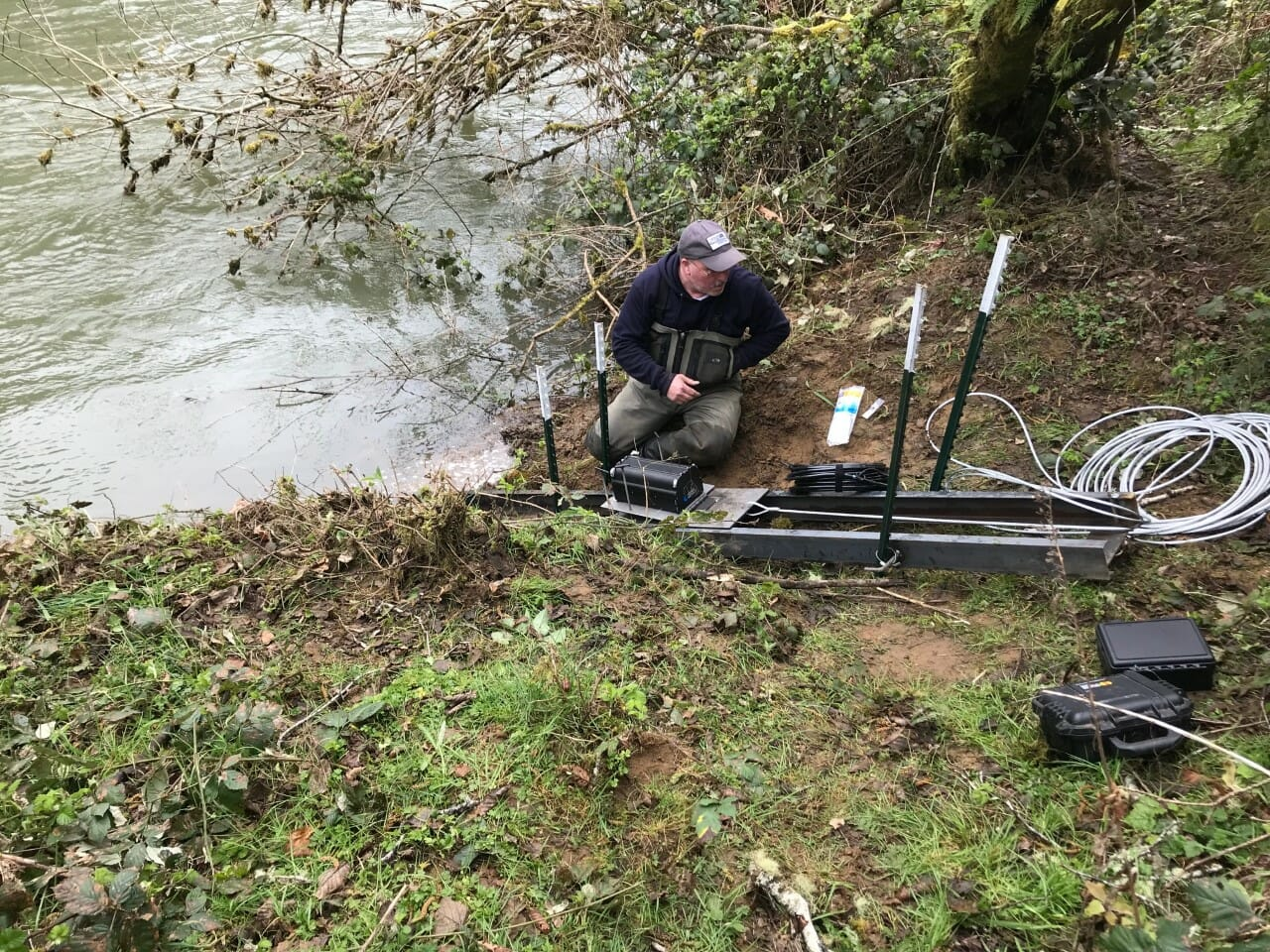 TU's Dean Finnerty checks on sonar equipment that counts fish moving up a southwest Oregon river.