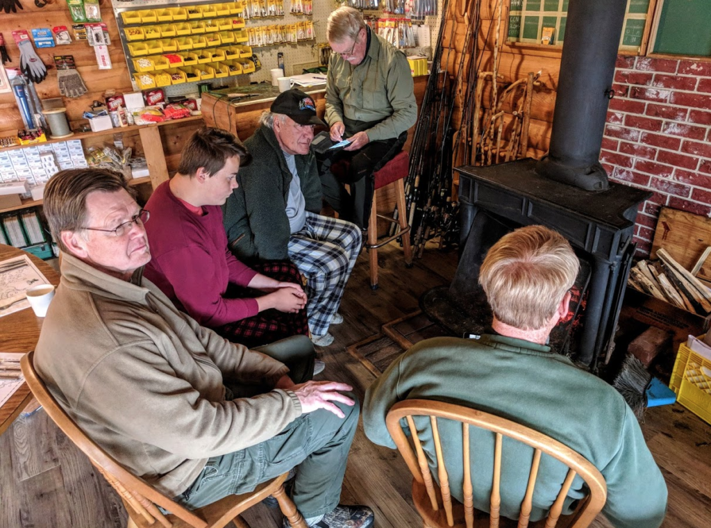 Anglers gathered around a wood stove at Laurie River Lodge, Manitoba.