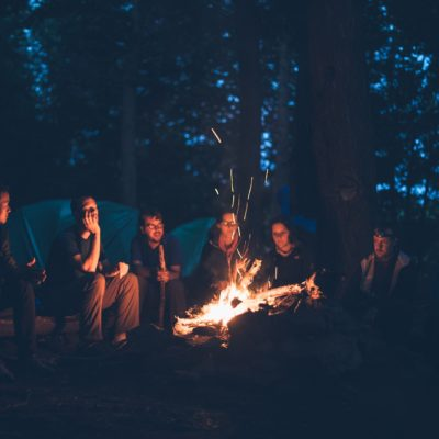 A group of people gathered around a campfire