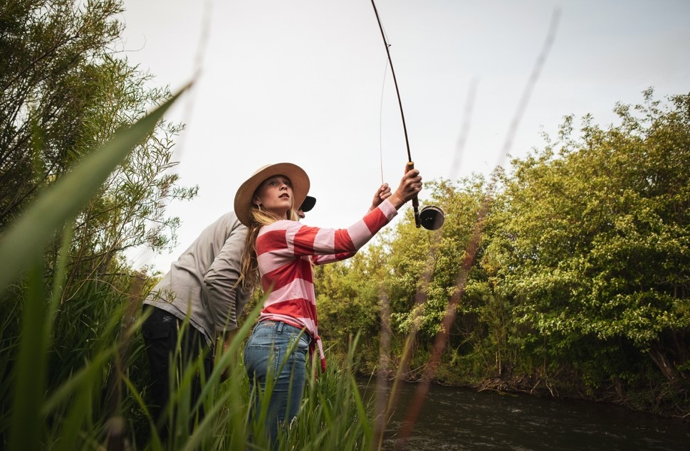A picture containing outdoor, sport, fishing, holding  Description automatically generated