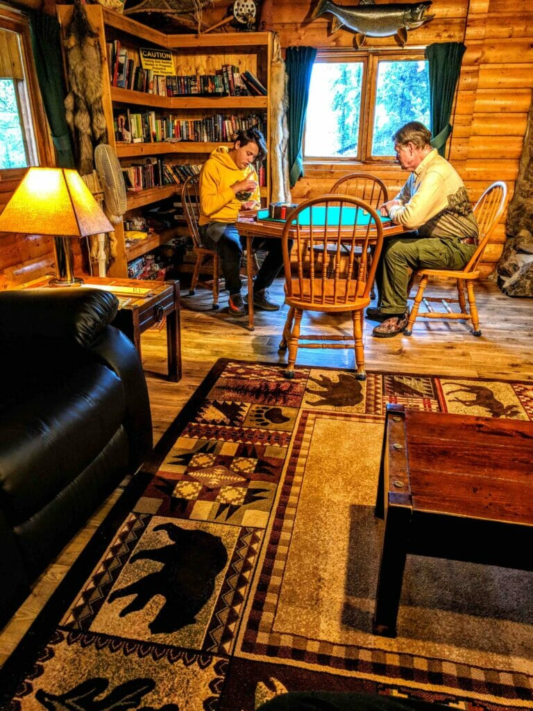 A boy plays cribbage with a friend.