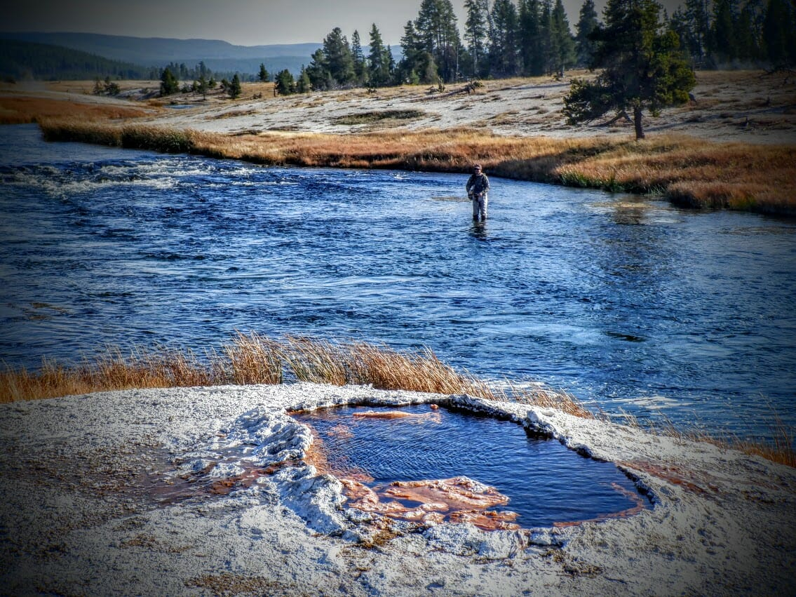 An angler fishes the Firehole River in Yellowstone National Park.