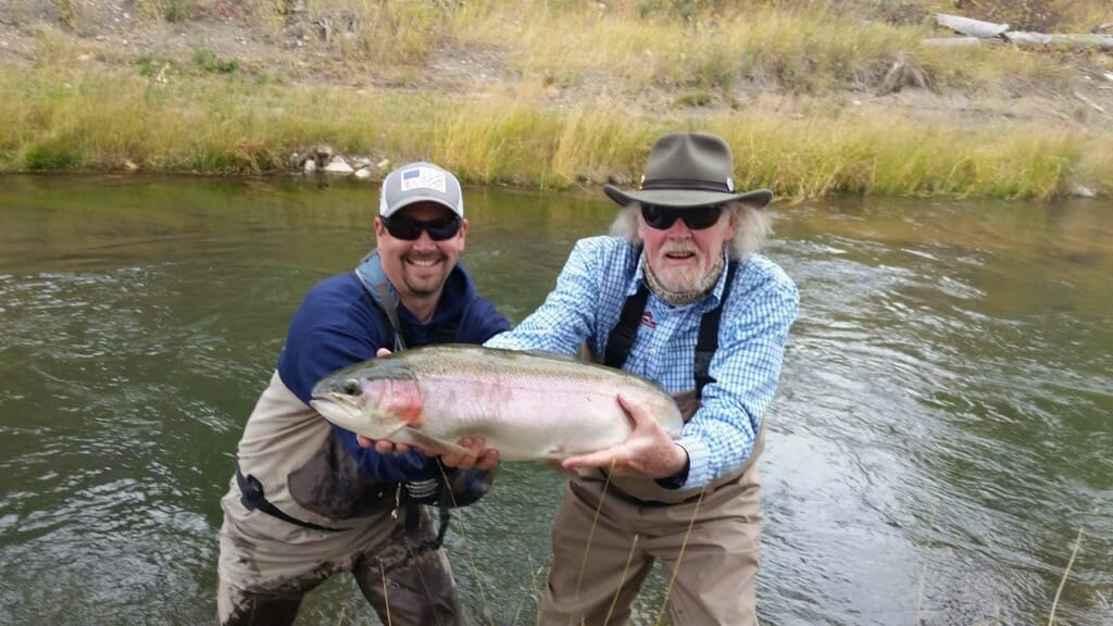Guide and client with a big rainbow trout.