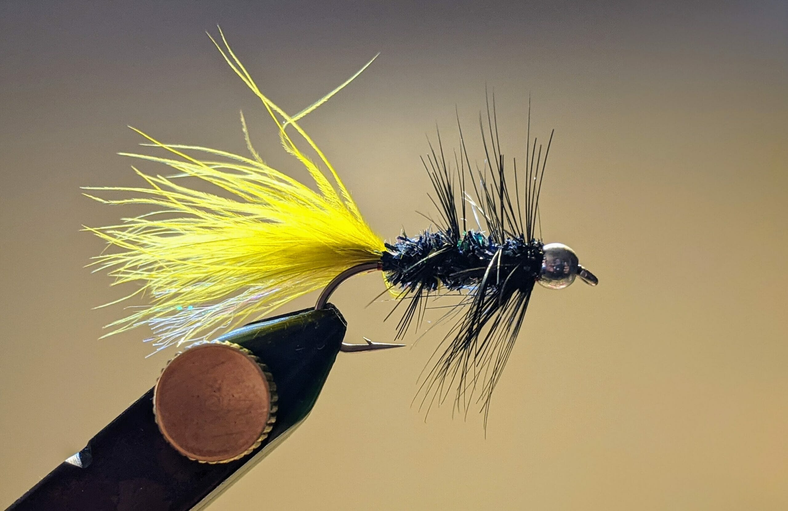 A Woolly Bugger in the vise.