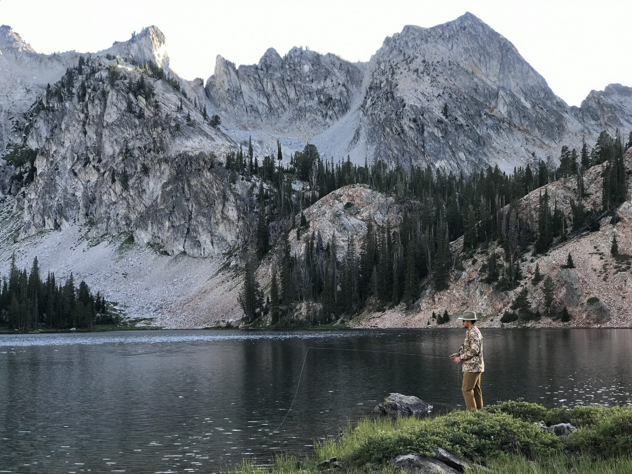 Casting for trout in a mountain lake.
